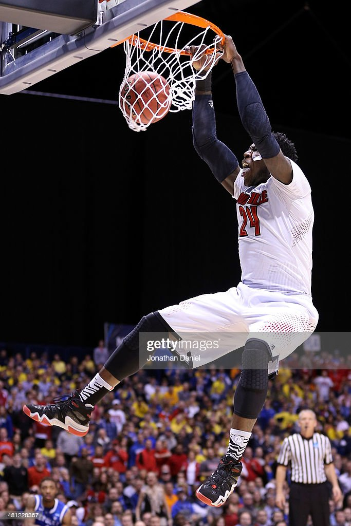 Montrezl Harrell of the Louisville Cardinals dunks the ball in the first half against the Kentucky Wildcats during the regional semifinal of the 2014...
