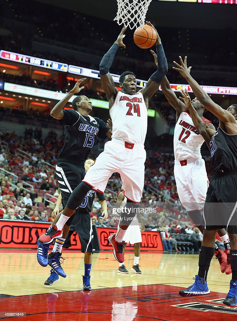 <a gi-track='captionPersonalityLinkClicked' href=/galleries/search?phrase=Montrezl+Harrell&family=editorial&specificpeople=9959702 ng-click='$event.stopPropagation()'>Montrezl Harrell</a> #24 of the Louisville Cardinals grabs a rebound during the game against the Missouri-Kansas City Kangaroos at KFC YUM! Center on December 4, 2013 in Louisville, Kentucky.