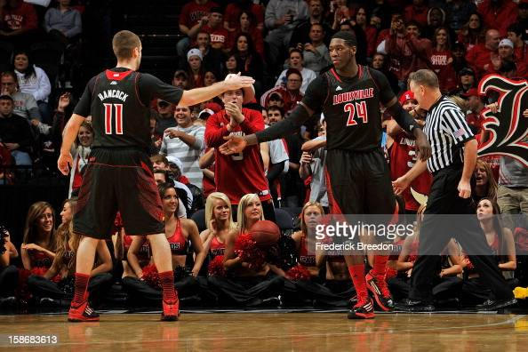 Montrezl Harrell of the Louisville Cardinals high fives teammate Luke Hancock after a play against of the Western Kentucky Hilltoppers at Bridgestone...