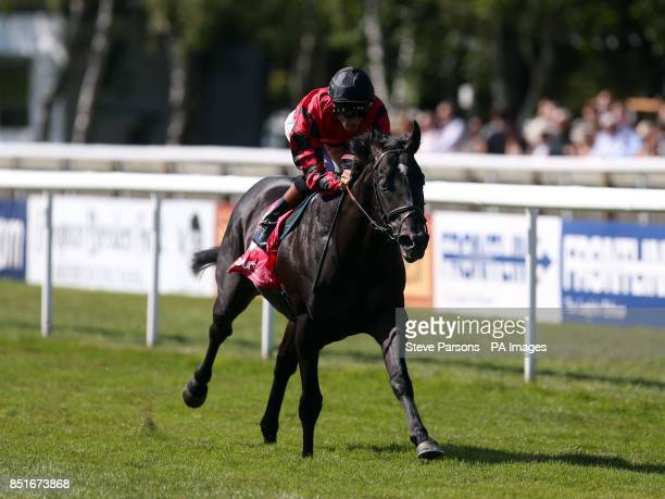 Montridge ridden by Richard Hughes wins the Insure Pink Stubbs Stakes during Boylesport Ladies Day of the PiperHeidsieck July Festival at Newmarket...