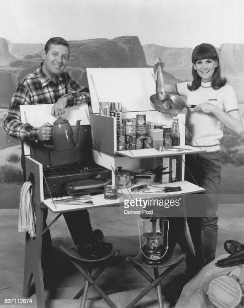 Monty Hall and Carol Merrill of NBC TV's Let's Make A Deal show off a three piece camp kitchen which can be built with a Denver PostSteve Ellingson...