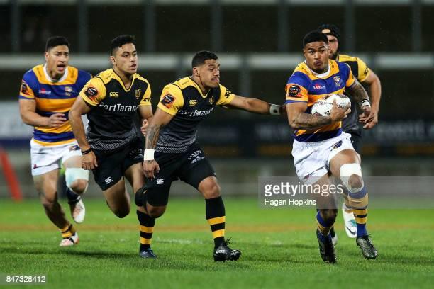 Monty Ioane of Bay of Plenty makes a break from Te Toiroa Tahuriorangi of Taranaki during the round five Mitre 10 Cup match between Taranaki and Bay...