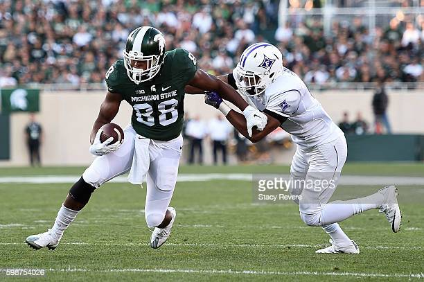 Monty Madaris of the Michigan State Spartans avoids a tackle by Thomas Brown of the Furman Paladins during the first half of a game at Spartan...