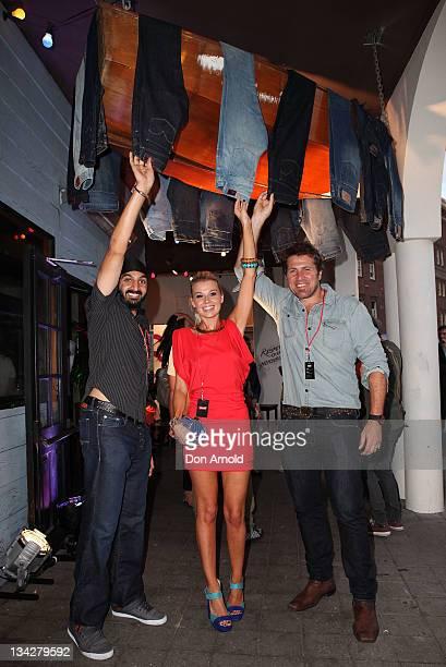 Monty Panesar Beck Stevens and Jason Stevens pose at a Levi's event to showcase the world's oldest pair of jeans at Bondi Beach on November 30 2011...