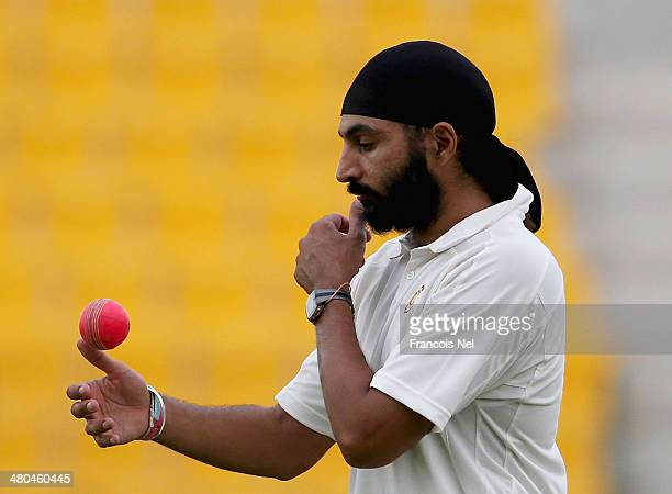 Monty Panesar inspects the new pink ball during day three of the Champion County match between Marylebone Cricket Club and Durham at Sheikh Zayed...