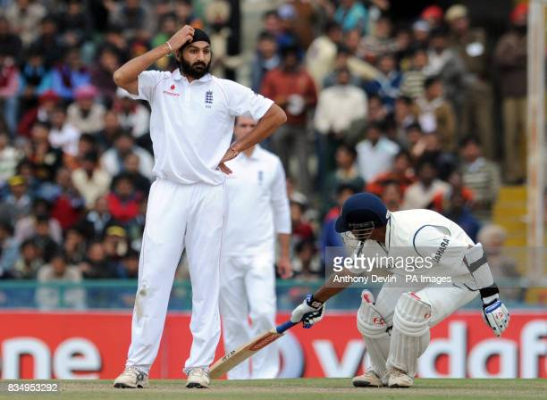 Monty Panesar lookson as Rahul Dravid scores runs during the first day of the second test at the Punjab Cricket Association Stadium Mohali India