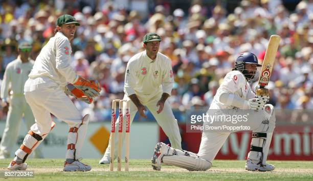 Monty Panesar of England batting during his lastwicket stand of 40 runs with Steve Harmison watched by Australia's Adam Glichrist and Ricky Ponting...