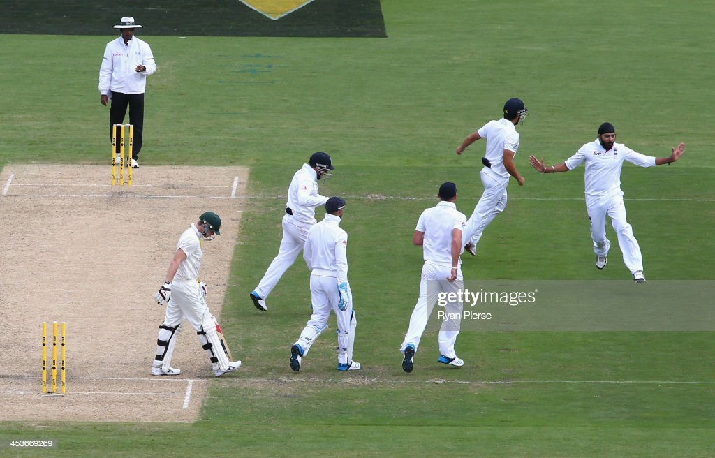 <a gi-track='captionPersonalityLinkClicked' href=/galleries/search?phrase=Monty+Panesar&family=editorial&specificpeople=592881 ng-click='$event.stopPropagation()'>Monty Panesar</a> of England celebrates after taking the wicket of Steve Smith of Australia during day one of the Second Ashes Test Match between Australia and England at Adelaide Oval on December 5, 2013 in Adelaide, Australia.