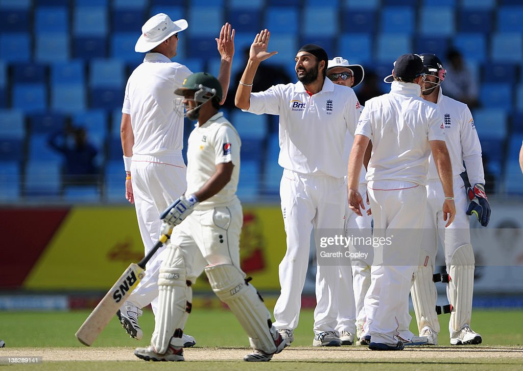 <a gi-track='captionPersonalityLinkClicked' href=/galleries/search?phrase=Monty+Panesar&family=editorial&specificpeople=592881 ng-click='$event.stopPropagation()'>Monty Panesar</a> of England celebrates with Stuart Broad after dismissing <a gi-track='captionPersonalityLinkClicked' href=/galleries/search?phrase=Asad+Shafiq&family=editorial&specificpeople=7061328 ng-click='$event.stopPropagation()'>Asad Shafiq</a> of Pakistan during the 3rd Test match between Pakistan and England at The Dubai International Stadium on February 5, 2012 in Dubai, United Arab Emirates.
