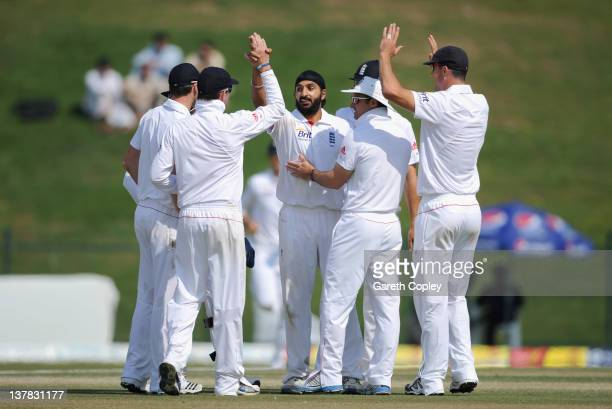 Monty Panesar of England celebrates with teammates after dismissing Saeed Ajmal of Pakistan during the second Test match between Pakistan and England...