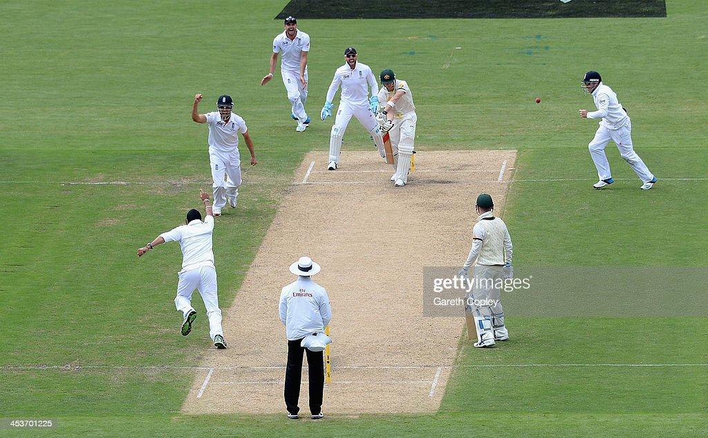 Monty Panesar of England celebrates with teammates after dismissing Steve Smith of Australia during day one of the Second Ashes Test Match between Australia and England at Adelaide Oval on December 5, 2013 in Adelaide, Australia.