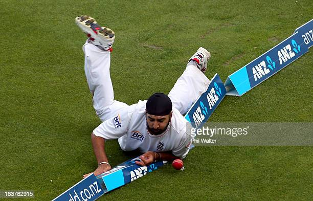 Monty Panesar of England fails to stop a four of the bat of Kane Williamson of New Zealand during day three of the second Test match between New...