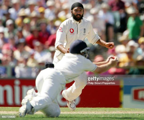 Monty Panesar of England watches as Ian Bell dives to take the catch to dismiss Australia's Adam Gilchrist for 0 during the 3rd Test match between...