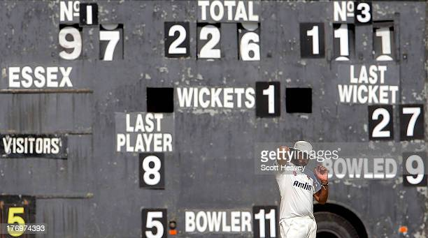 Monty Panesar of Essex in front of the scoreboard during day one of the LV County Championship Division Two game between Essex and Northamptonshire...