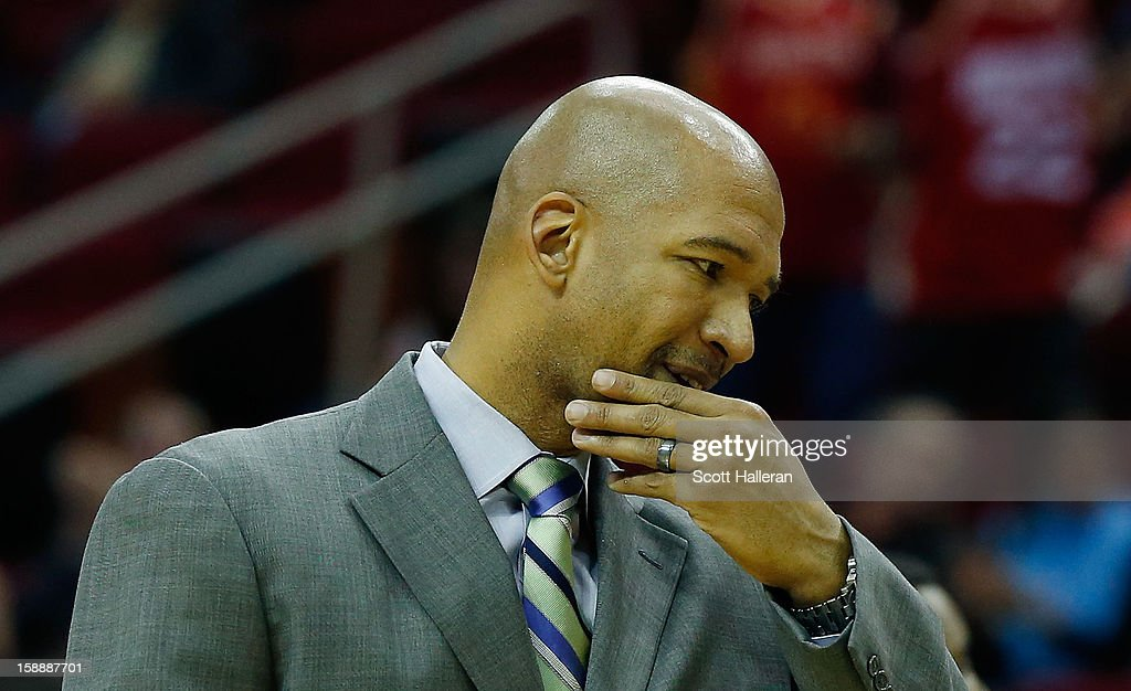 Monty Williams, head coach of the New Orleans Hornets, calls a time-out against the Houston Rockets at Toyota Center on January 2, 2013 in Houston, Texas.