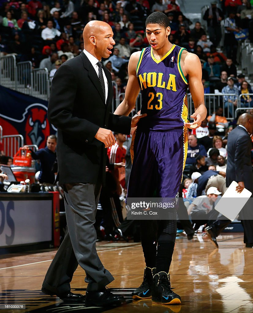 Monty Williams of the New Orleans Hornets converses with Anthony Davis during the game against the Atlanta Hawks at Philips Arena on February 8 2013...