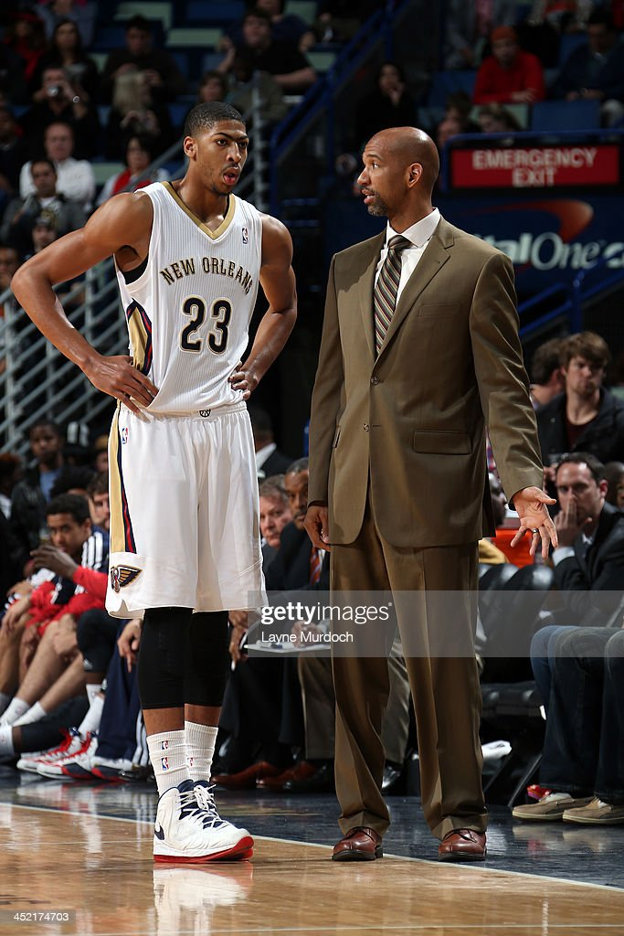 Monty Williams of the New Orleans Pelicans talks with Anthony Davis during the game against the Golden State Warriors on November 26 2013 at the New...