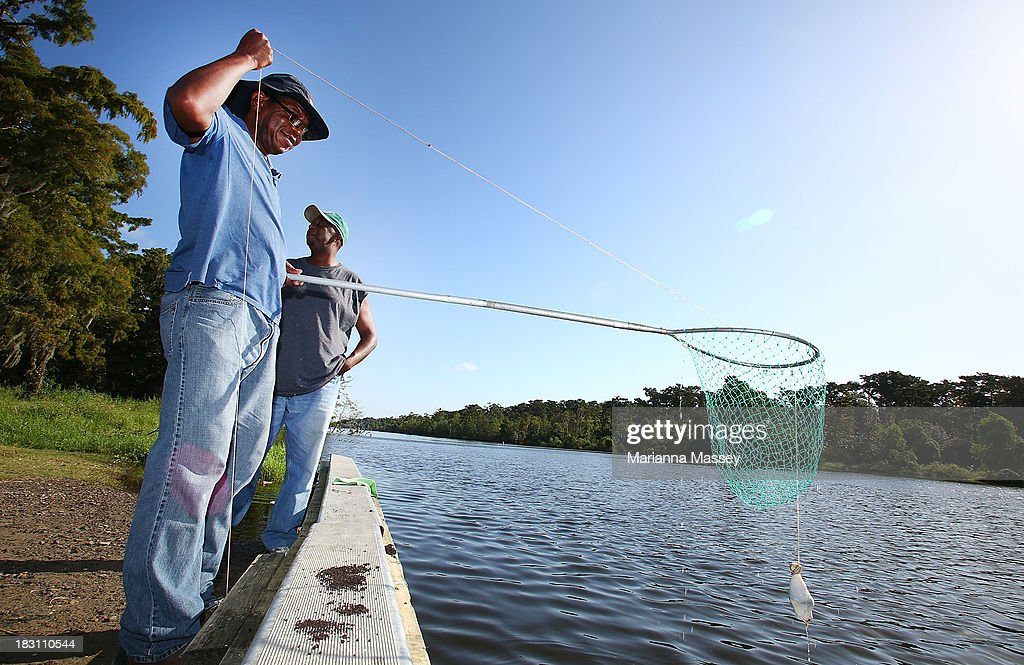 It was business as usual for Mike Coleman and Jarad Williams as they check their crab traps ahead of Tropical Storm Karen on October 4, 2013 in Grand Isle, Louisiana. Louisiana authorities issued a mandatory evacuation of low-lying areas even as Tropical Storm Karen weakened while moving through the Gulf of Mexico.