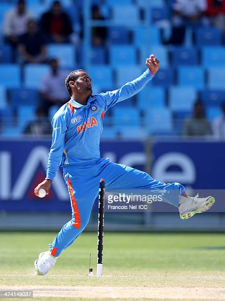 Monu Kumar of India bowls during the ICC U19 Cricket World Cup 2014 Quarter Final match between England and India at the Dubai Sports City Cricket...