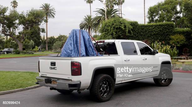 A monument honoring Confederate soldiers is covered in blue tarp after being removed from the Hollywood Forever Cemetery Wednesday morning August 16...