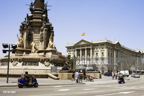 Monument in front of a building, Christopher Columbus, Barcelona, Spain : Stock Photo
