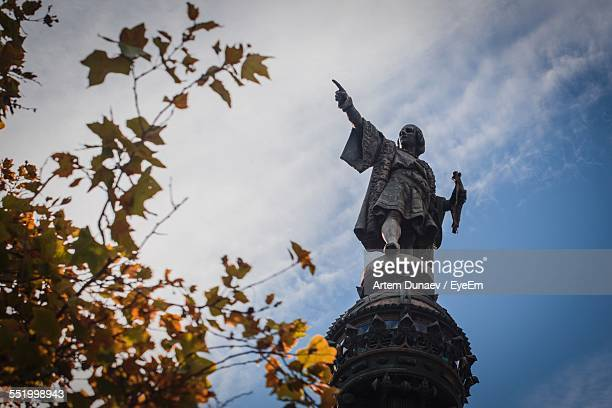 Monument Of Christopher Columbus Against Cloudy Sky