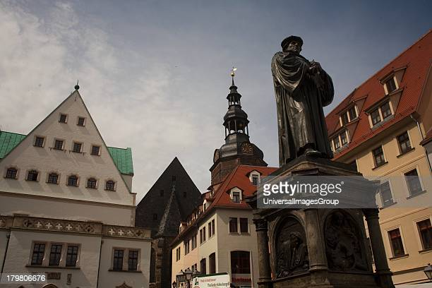 Monument of Reformer Martin Luther in Town Square of Eisleben Germany the place of his birth and death in the 1500s now a UNESCO World Heritage Site