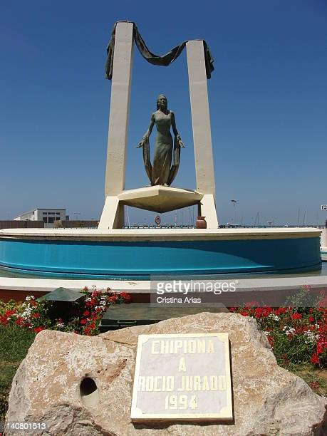 Monument of Rocio Jurado singer located at the entrance of the Marina beside the Guadalquivir River and the National Park of Donana and looking over...