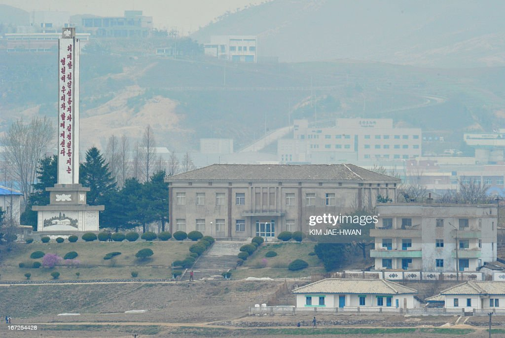 A monument praising the leadership of North Korea's late leaders stands in a showcase North Korean village in the demilitarised zone on April 23, 2013