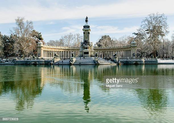 Monument to Alfonso XII with snow in Retiro lake