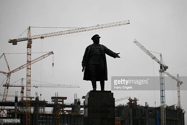 A monument to Sergei Kirov is seen in front of the Kirov Stadium which is still under construction on October 31 2011 in Saint Petersburg Russia St...