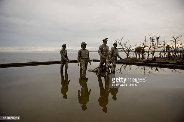 A monument to US General Douglas MacArthur at the point of his 1944 landing is seen next to to uprooted trees in the MacArthur memorial park in the...