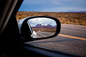 Monument Valley reflected in side-view mirror
