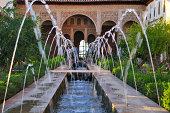Generalife courtyard, incredibly beautiful Moorish architecture. Monumental complex of the Alhambra. Generalife. Granada, Andalucia, Spain.