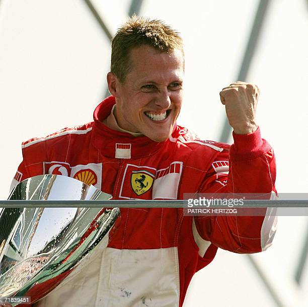 German Ferrari driver Michael Schumacher celebrates on the podium of the Monza racetrack after the Italian Formula One Grand prix 10 September 2006...