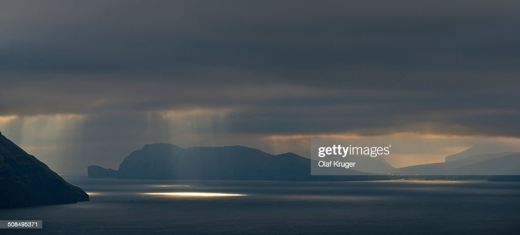 Mood light with low-hanging clouds, Koltur and Vagar islands, Faroe Islands, Denmark