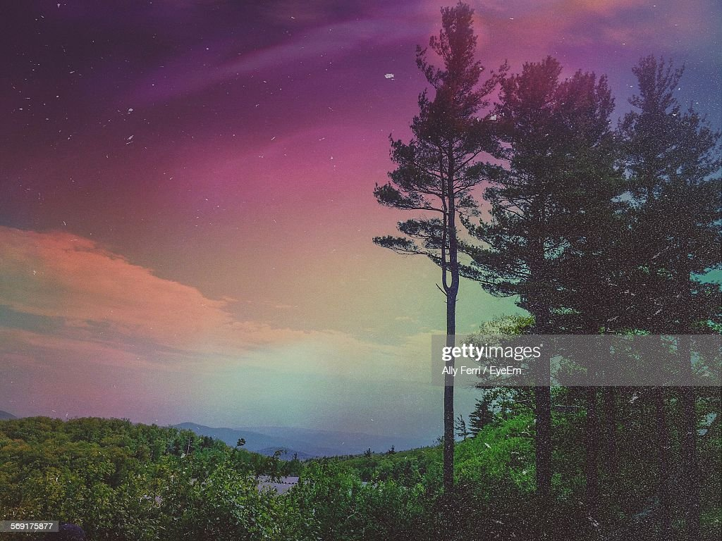 Moody Dawn Sky Over Mountain Landscape