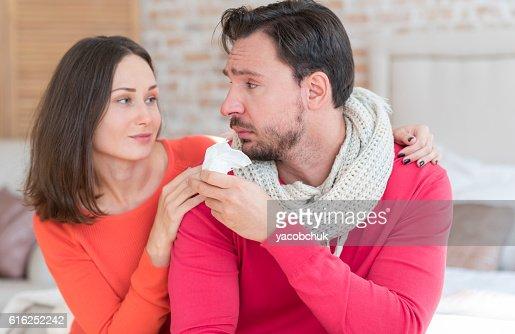Moody miserable man looking at his girlfriend : Stock Photo