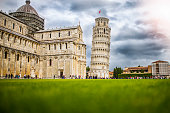 Famous Pisa tower in Italy, European popular travel destination, rainy day, tourists and travel, stone tower, architectural phenomenon