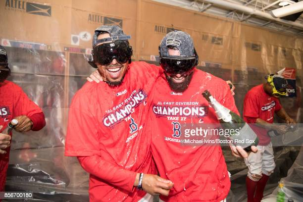 Mookie Betts and Deven Marrero of the Boston Red Sox celebrate after the team clinched the American League East pennant with a win over the Houston...