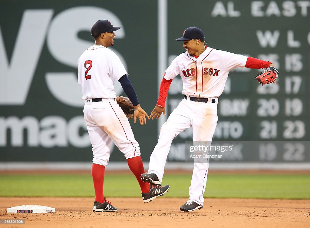 Mookie Betts #50 and Xander Bogaerts #2 of the Boston Red Sox celebrate after their victory over the Cleveland Indians at Fenway Park on May 21, 2016 in Boston, Massachusetts.