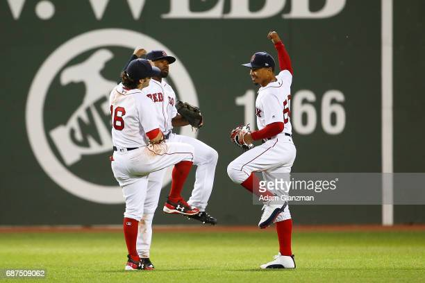 Mookie Betts Andrew Benintendi and Jackie Bradley Jr #19 of the Boston Red Sox celebrate after a victory over the Texas Rangers at Fenway Park on May...