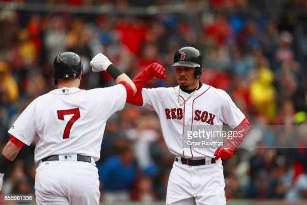 Mookie Betts celebrates with Christian Vazquez of the Boston Red Sox after scoring in the bottom of the fourth inning during the game against the...