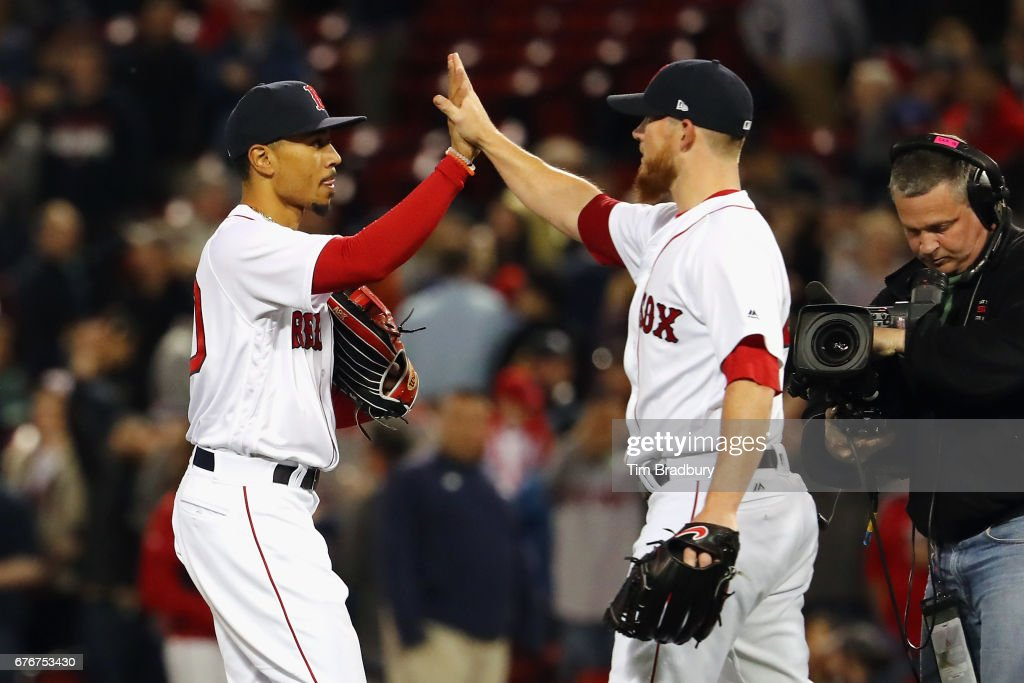 Mookie Betts #50 celebrates with Craig Kimbrel #46 of the Boston Red Sox after defeating the Baltimore Orioles 5-2 at Fenway Park on May 2, 2017 in Boston, Massachusetts.