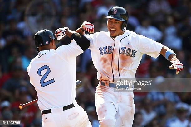 Mookie Betts celebrates with Xander Bogaerts of the Boston Red Sox after hitting a solo home run in the seventh inning during the game against the...
