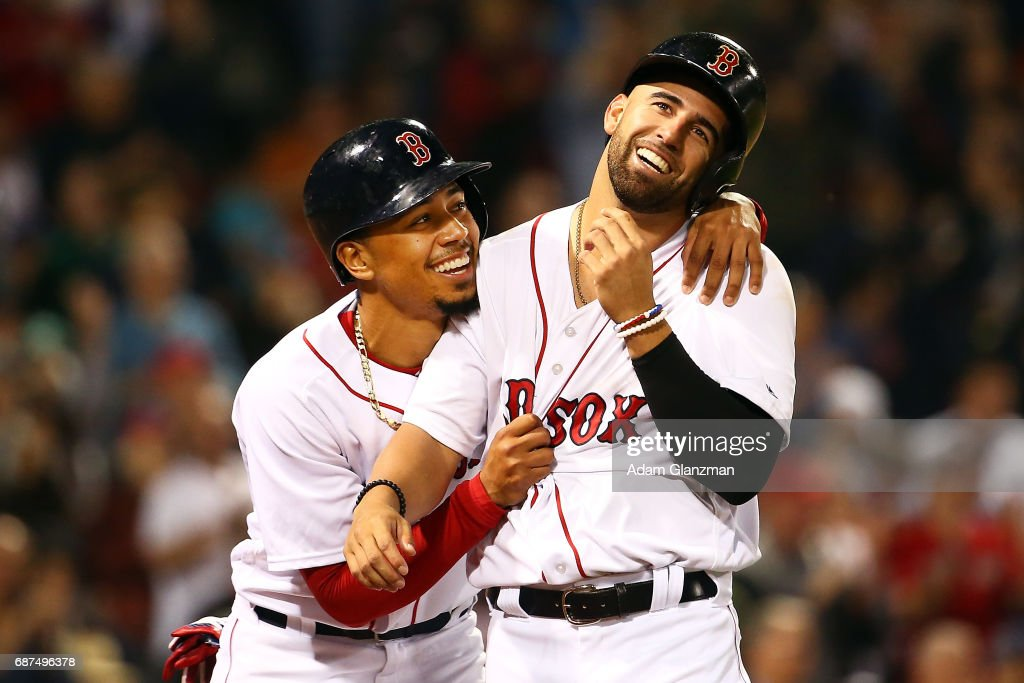 Mookie Betts #2 hugs Deven Marrero #17 of the Boston Red Sox after scoring in the sixth inning of a game against the Texas Rangers at Fenway Park on May 23, 2017 in Boston, Massachusetts.