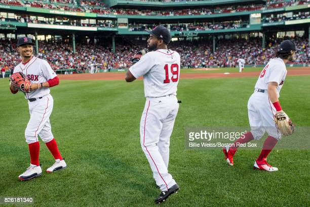 Mookie Betts Jackie Bradley Jr #19 and Andrew Benintendi of the Boston Red Sox react before a game against the Chicago White Sox on August 3 2017 at...
