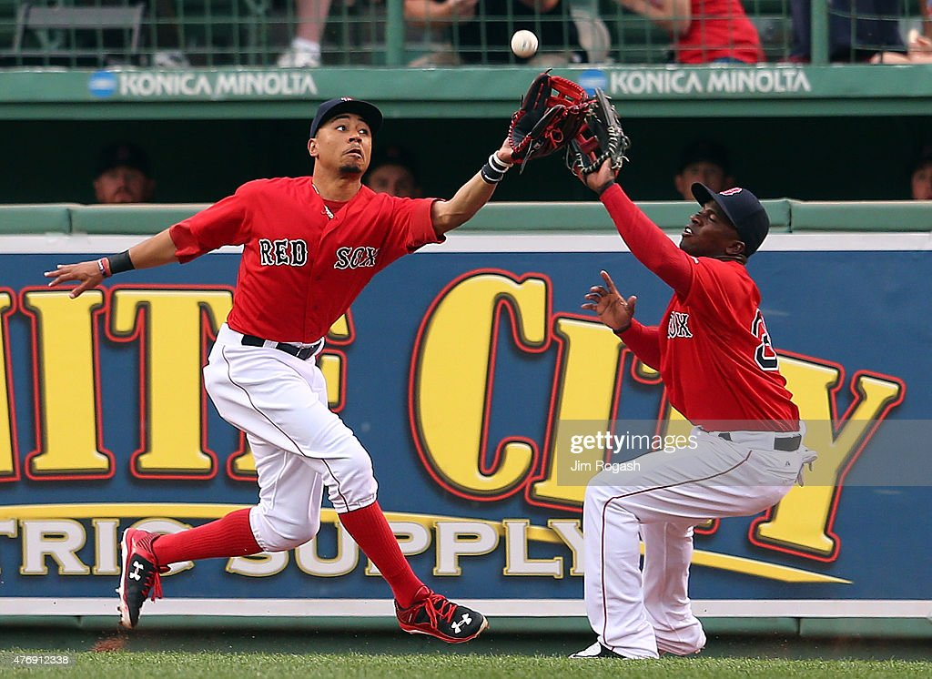 <a gi-track='captionPersonalityLinkClicked' href=/galleries/search?phrase=Mookie+Betts&family=editorial&specificpeople=12732023 ng-click='$event.stopPropagation()'>Mookie Betts</a> #50 of the Boston Red Sox almost collides with <a gi-track='captionPersonalityLinkClicked' href=/galleries/search?phrase=Rusney+Castillo&family=editorial&specificpeople=8450837 ng-click='$event.stopPropagation()'>Rusney Castillo</a> #38 of the Boston Red Sox but makes the catch during the first inning during a game with the Toronto Blue Jays at Fenway Park on June 12, 2015 in Boston, Massachusetts.