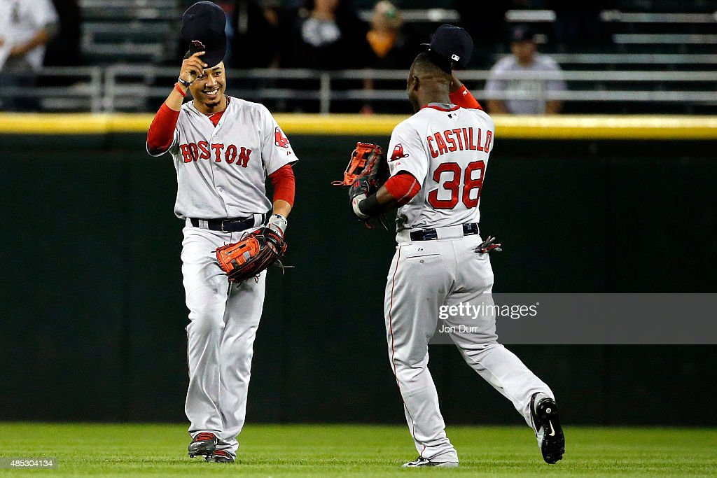 Mookie Betts #50 of the Boston Red Sox (L) and Rusney Castillo #38 celebrate their win over the Chicago White Sox at U.S. Cellular Field on August 26, 2015 in Chicago, Illinois. The Boston Red Sox won 3-0.