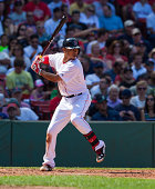 Mookie Betts of the Boston Red Sox bats during the third inning against the Seattle Mariners at Fenway Park on August 23 2014 in Boston Massachusetts...